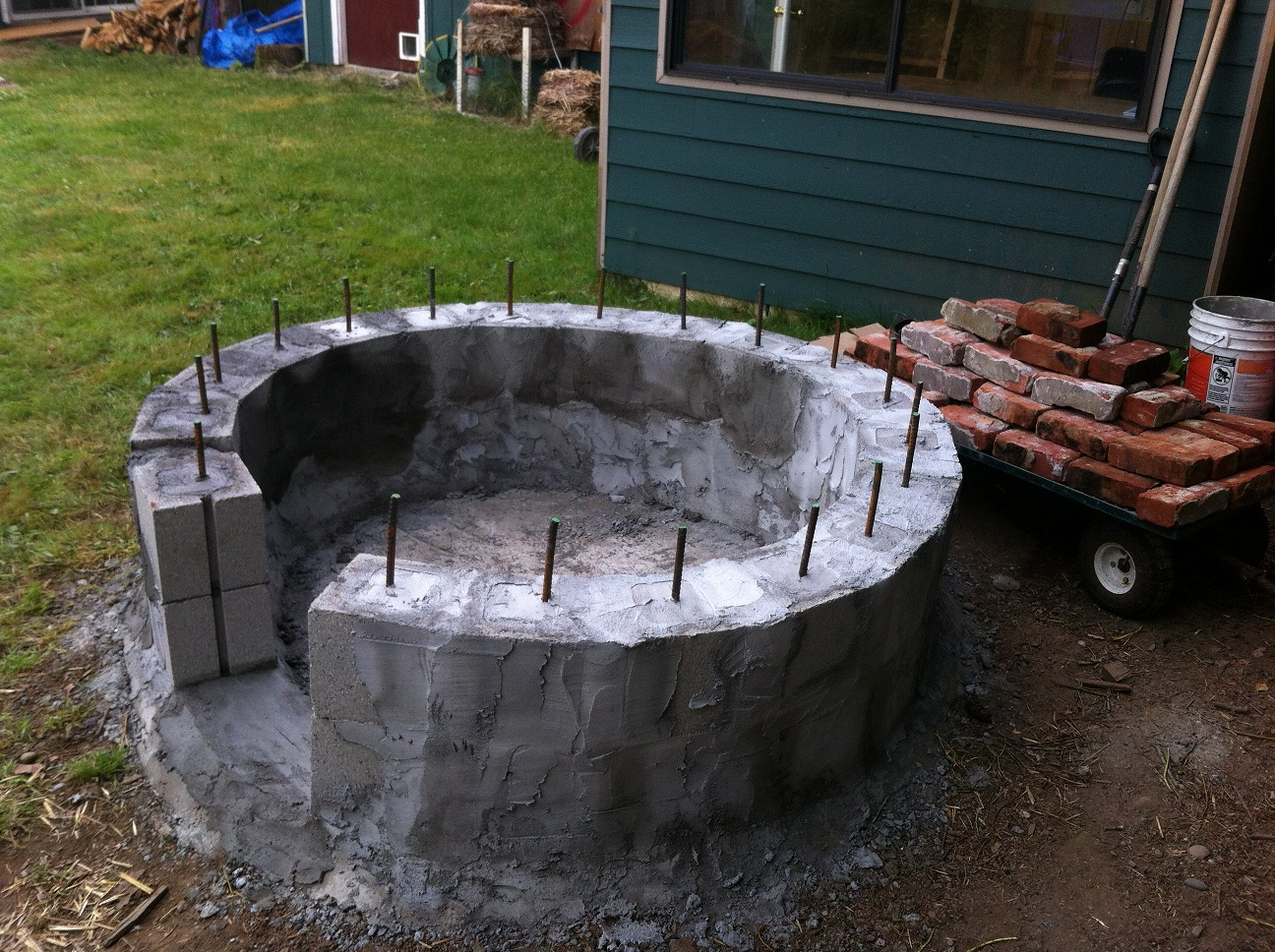 Hot tub pizza oven henry 39 s cabin for Diy concrete bathtub